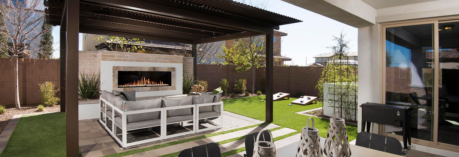 Ambition at Recker Pointe backyard with grass, pergola, and outdoor fireplace