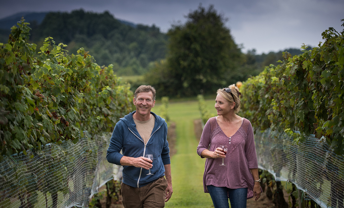 Couple in Vineyards with Wine
