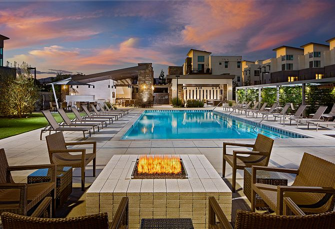 The District at Northridge Pool Area Surrounded by Cabanas. Lounge Chairs, and Fire Pit