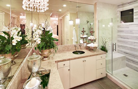 Plan 2X master bathroom with vanity, mirrors, chandelier, and walk-in shower