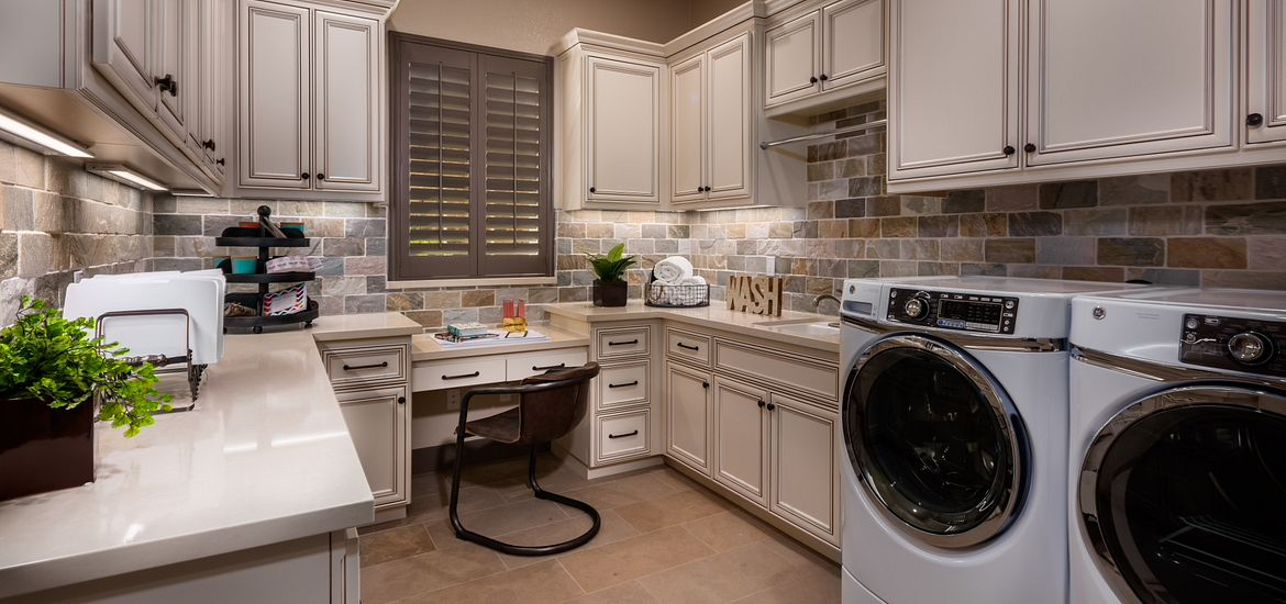 Technology upgrades for new homes in laundry room with desk and cabinetry