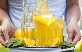 Person holding lemonade