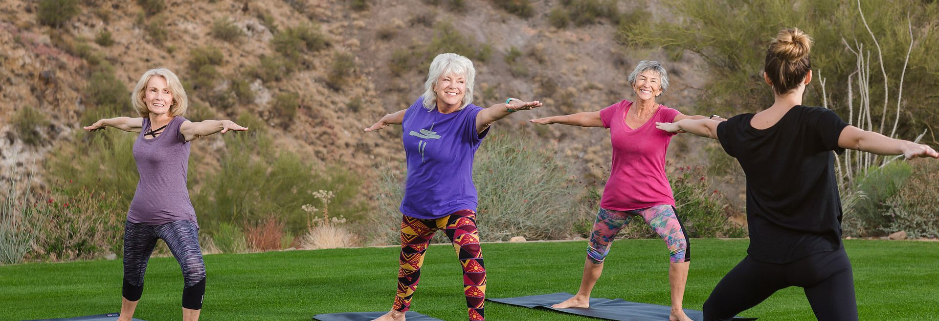 Trilogy members doing yoga in a group fitness class at Trilogy Wickenburg Ranch in Wickenburg, AZ