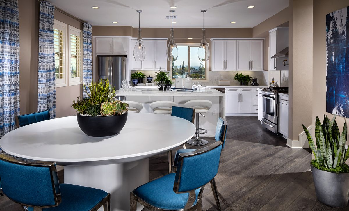 Residence 6 Kitchen with White Cabinets large island with seating and dining area