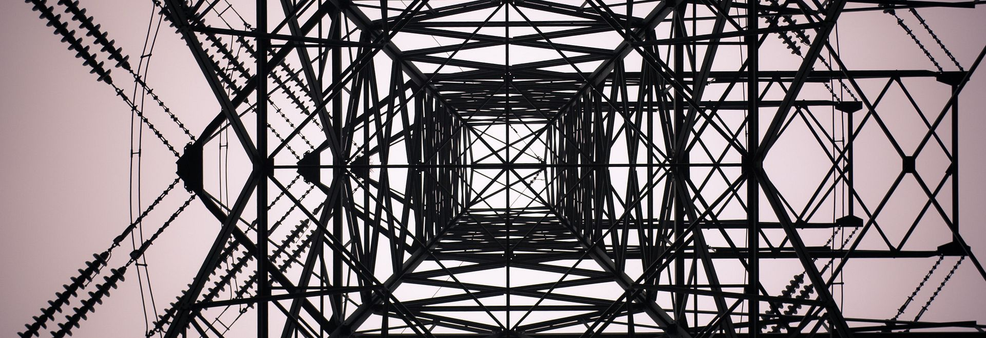 Looking upward through a transmission power tower