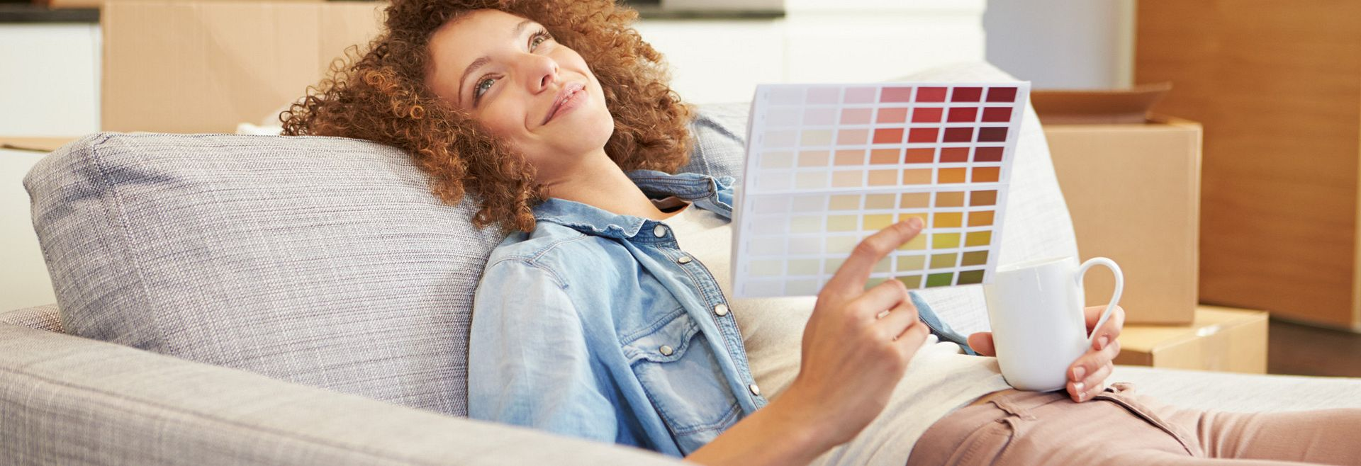 Woman Laying on Couch With Color Book