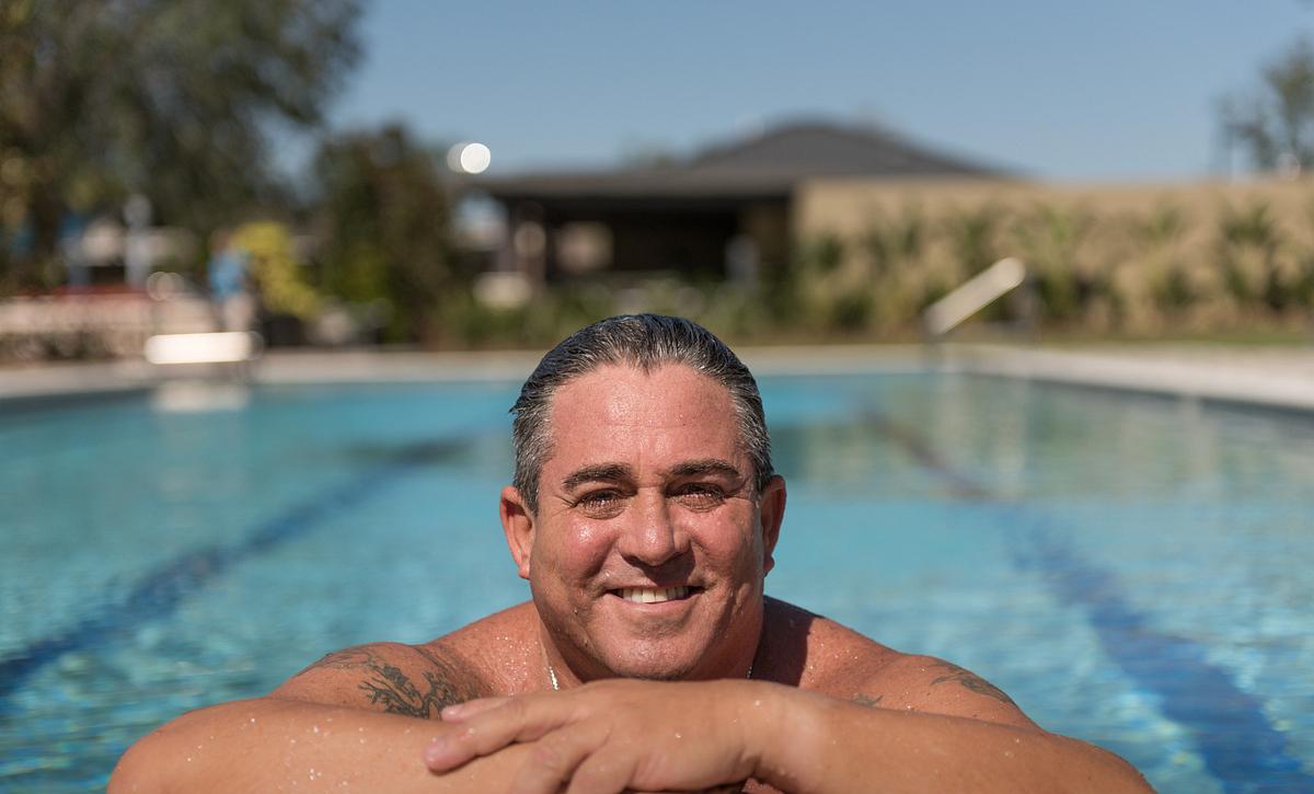 Trilogy Homeowner Enjoying the Pool