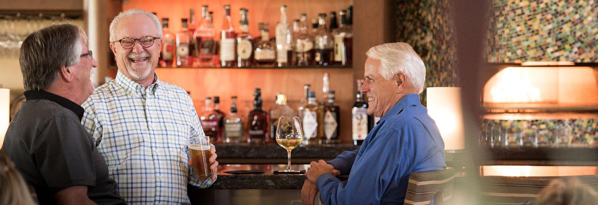 Men enjoying a drink at the bar