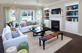 Family room with gas fireplace flanked by 2 media niche cabinets