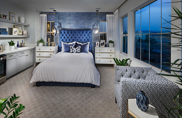 Plan 1 master bedroom with bed, dresser, windows, night stands, pendant lights, and built-in cabinets