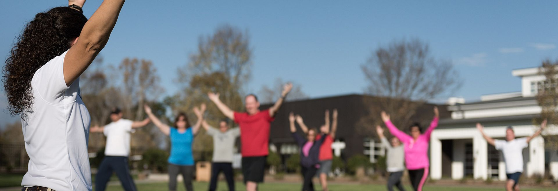 Outdoor Group fitness class with instructor