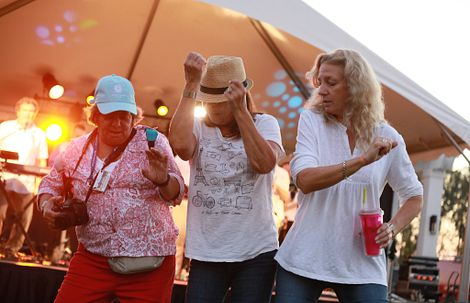 Ladies dancing at an outdoor concert