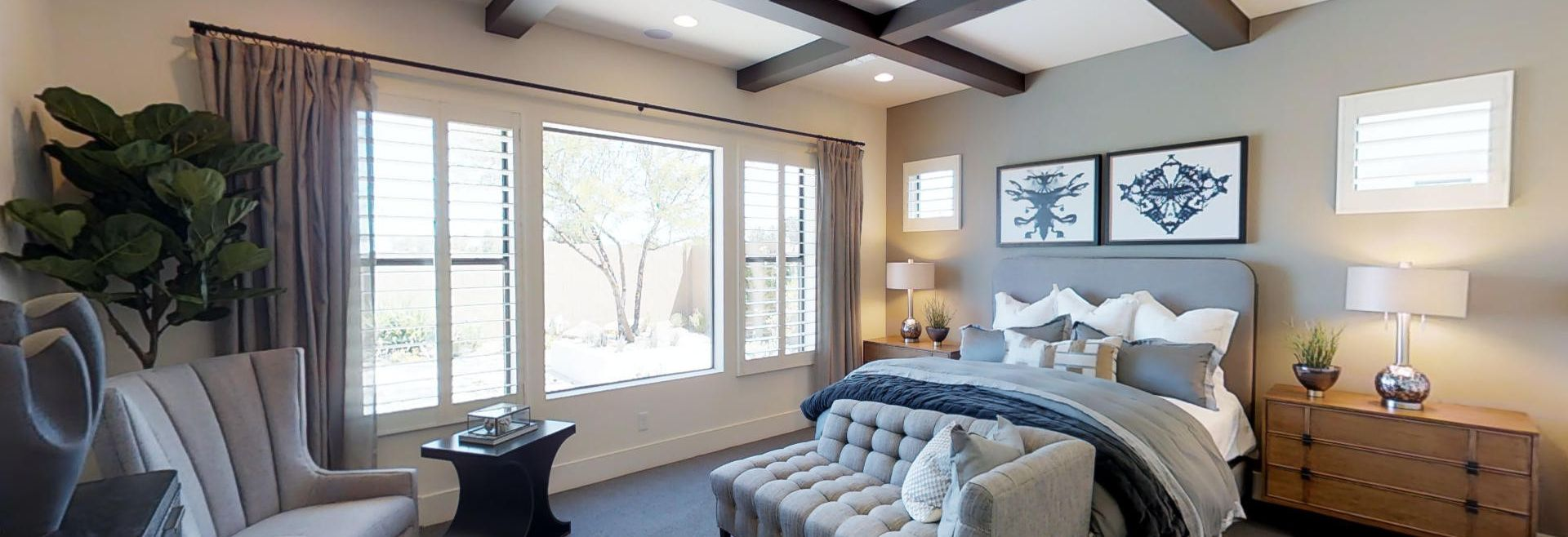 Plan 3 Master Bedroom with large window and beams on ceiling
