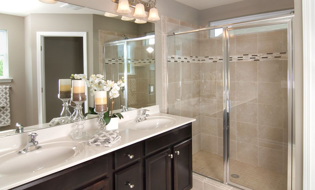 Master bathroom with large walk-in tiled shower and dual sink vanity