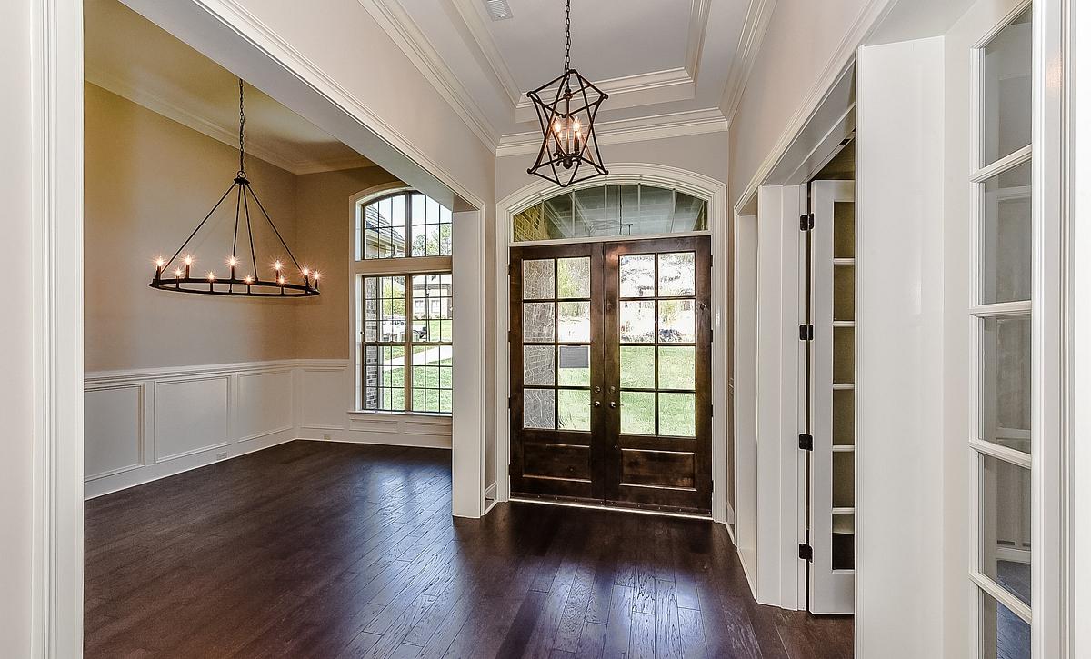 Foyer with wooden front door