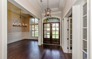 Foyer with wooden front door