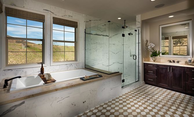 Plan 4 master bathroom with walk in shower, soaking tub, and vanity with large mirror