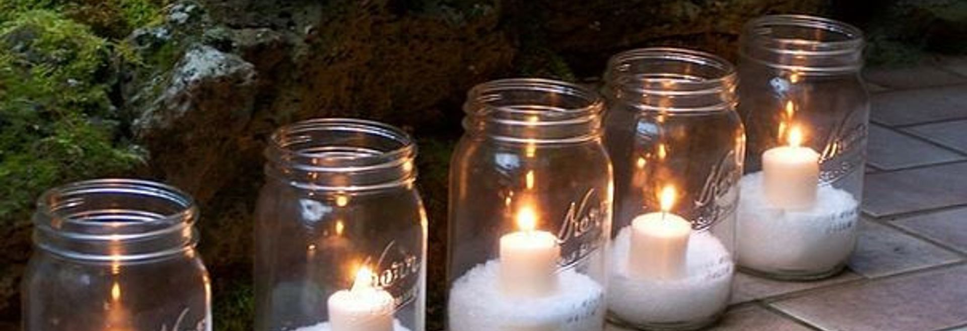 5 mason jar luminarias lined up