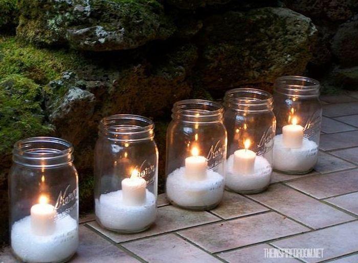 5 mason jar luminarias lined up