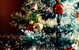Closeup of Christmas tree with hanging decorations