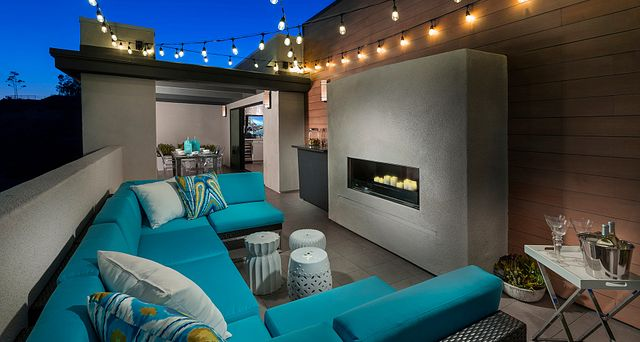 Plan 2X penthouse showing outdoor furniture, string lights, and fireplace