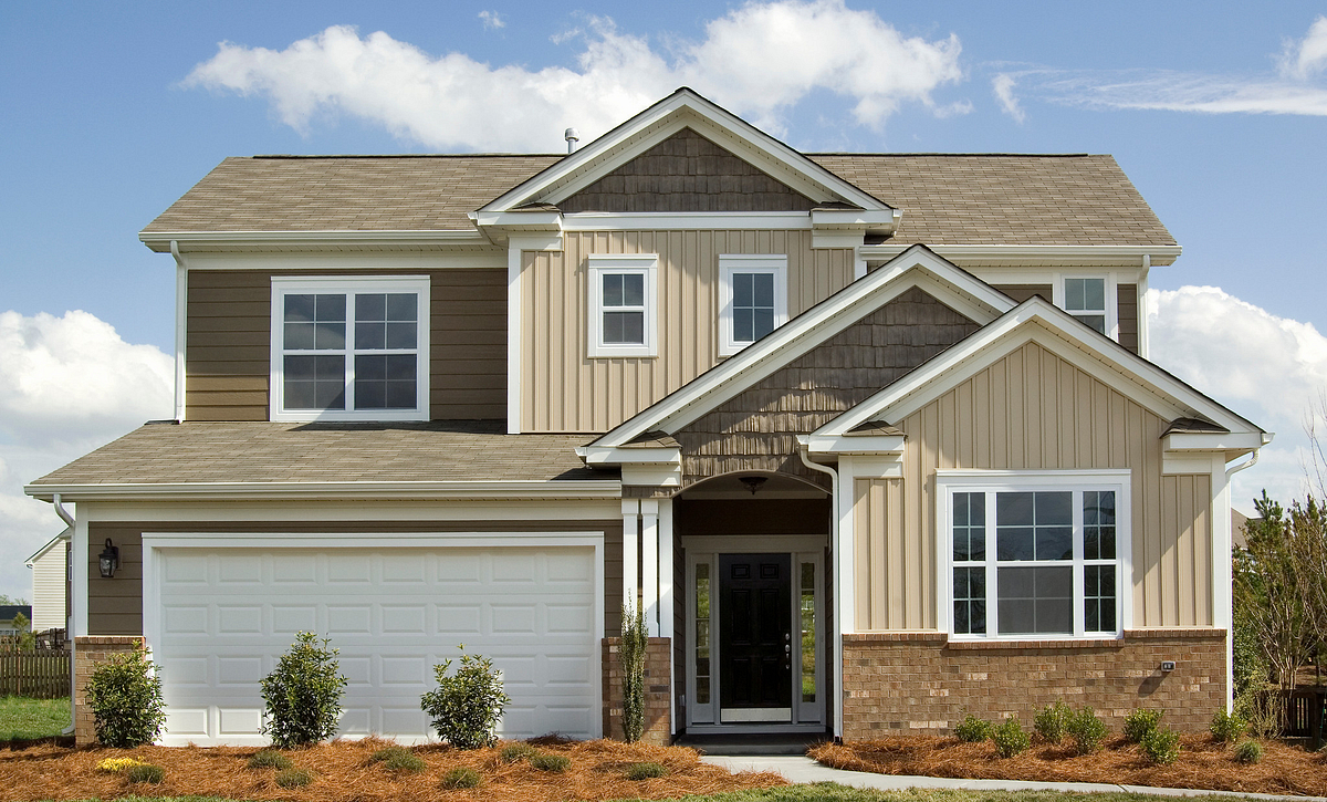 2-story home with siding and brick accents