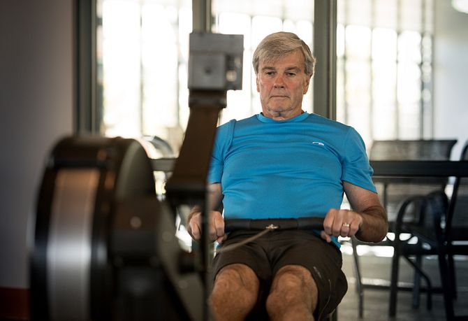 Man on rowing machine