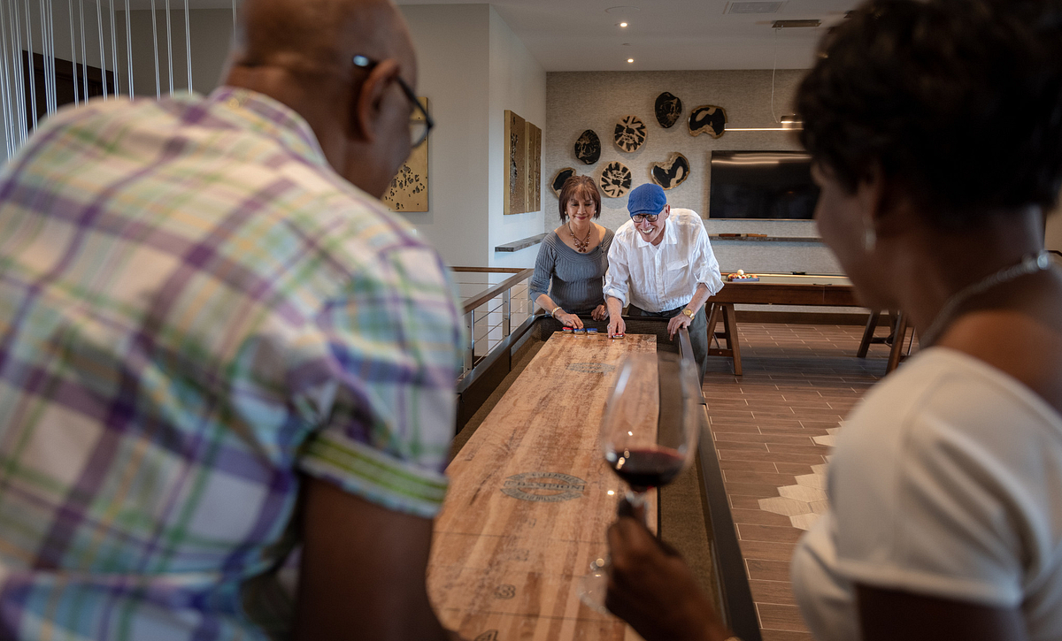 Trilogy Homeowners Play Shuffleboard