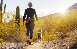 Woman walking Dog in the Desert