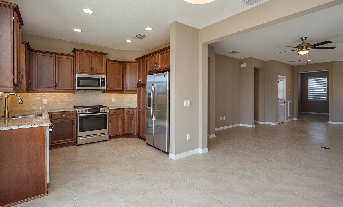 Trilogy at Ocala Preserve Quick Move In Home Naples Plan Kitchen & Great Room