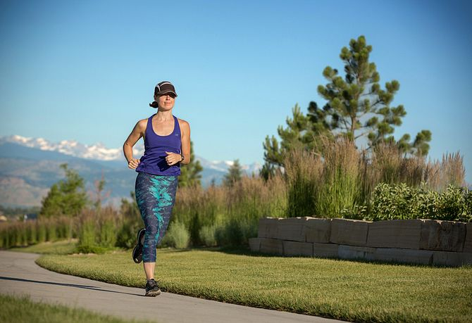 Woman running on hard surface trail