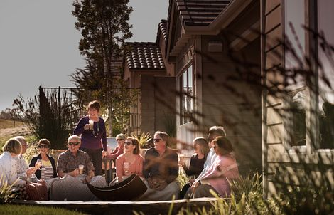 homeowners hanging out in a backyard