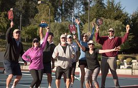 Group post pickleball game on courts