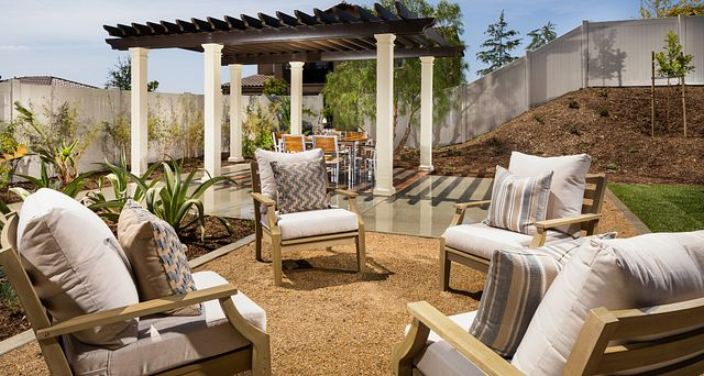 Plan 2 backyard with pergola, grass, and outdoor furniture