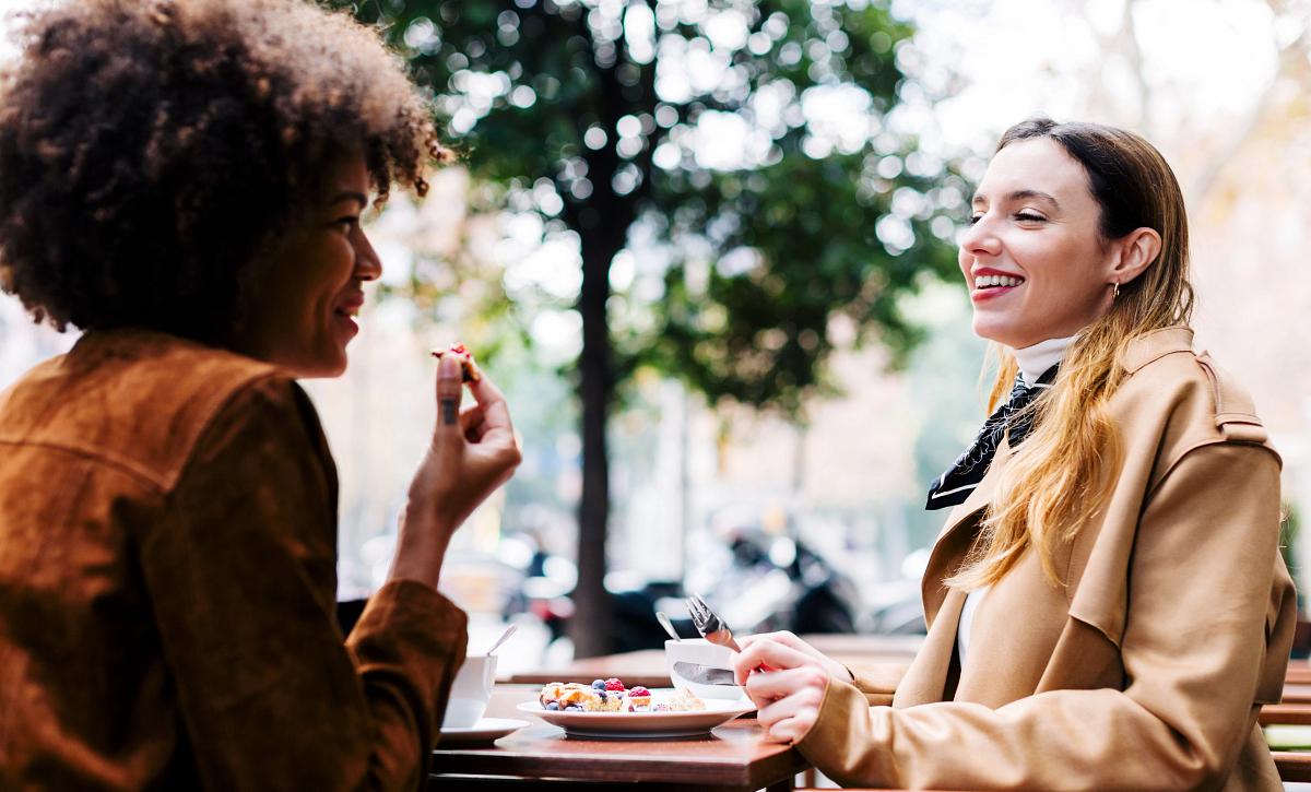 Lyric Women Eating Outside Restaurant