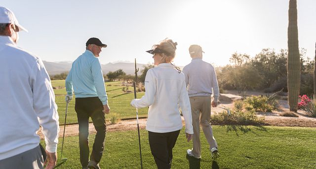 Residents of the active 55+ community playing golf in the Verde River Golf Club