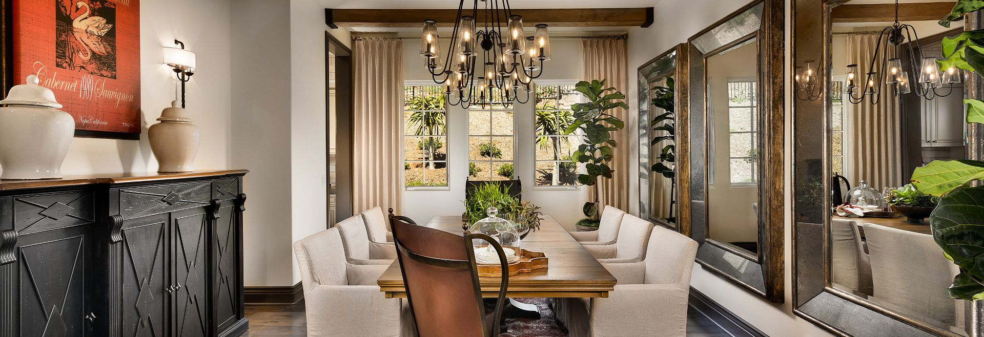 Plan 7 Dining Room with table, surrounding chairs, and chandelier