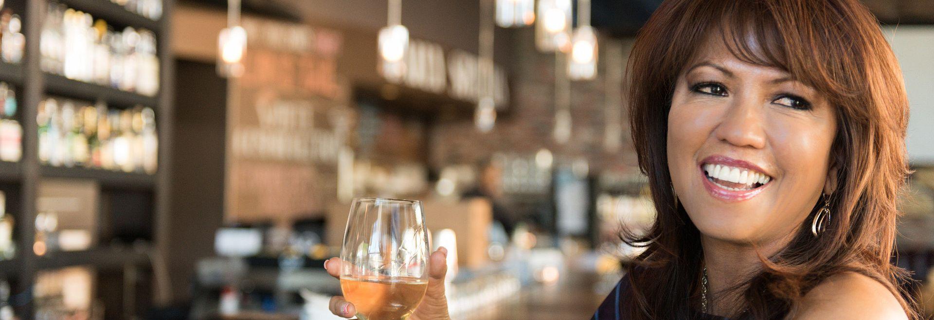 Woman enjoying a drink at the bar