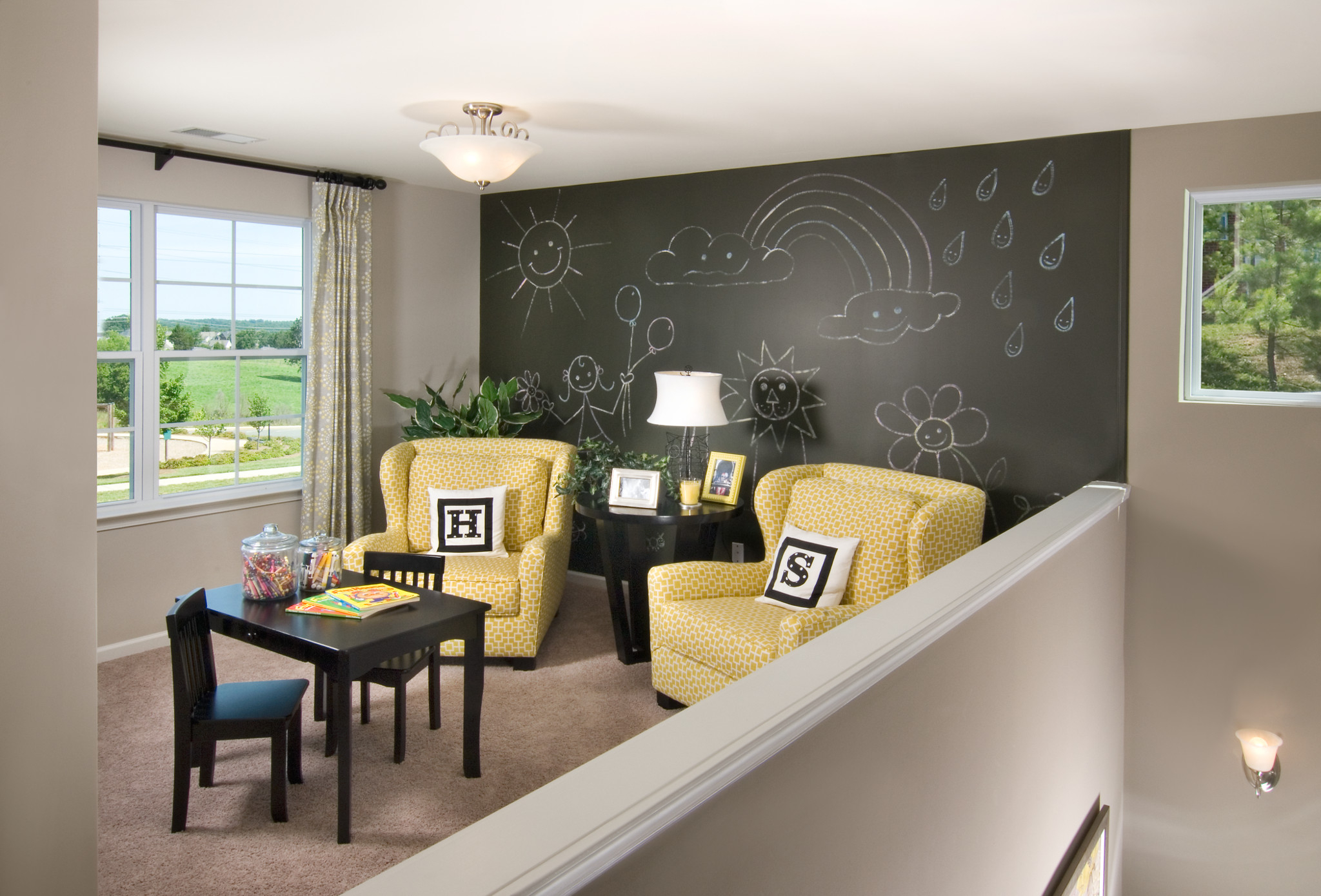 Loft with chalkboard accent wall