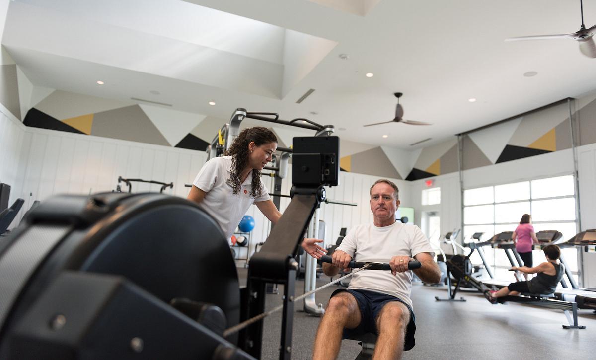 Man Exercising in Fitness Studio