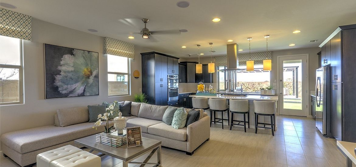 Interior view of kitchen of model home at Ambition at Eastmark