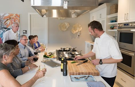 Group of people in a cooking demo with Executive Chef
