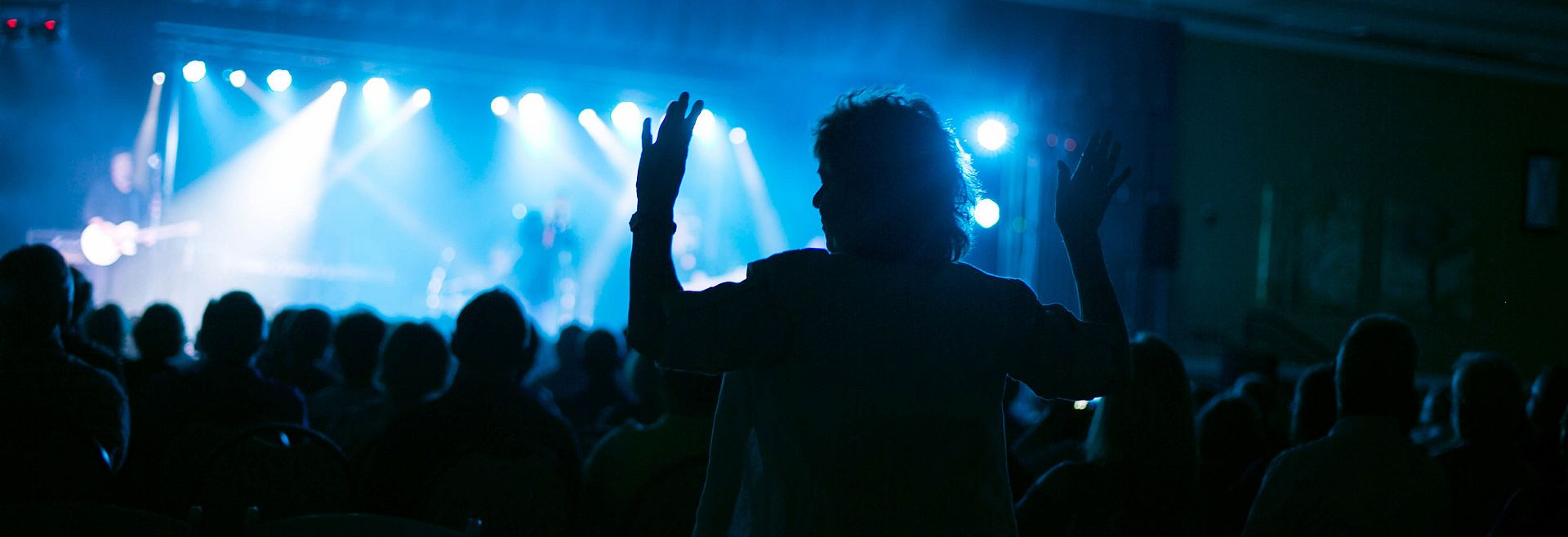 Lady Dancing at a Concert in Event Center