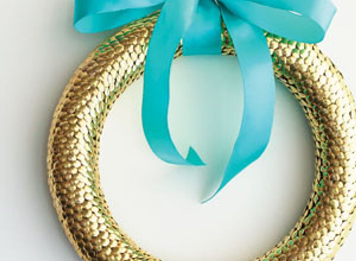 Gold wreath hanging with blue bow