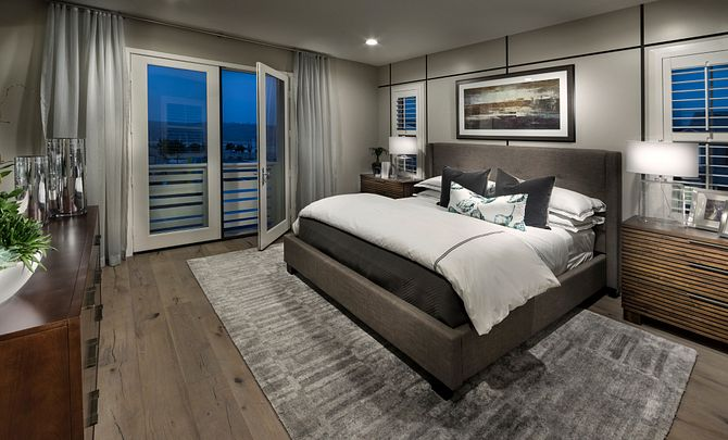 Plan 3 master bedroom with bed, wood floors, night stands, table lamps, dresser, french doors, and recessed lights