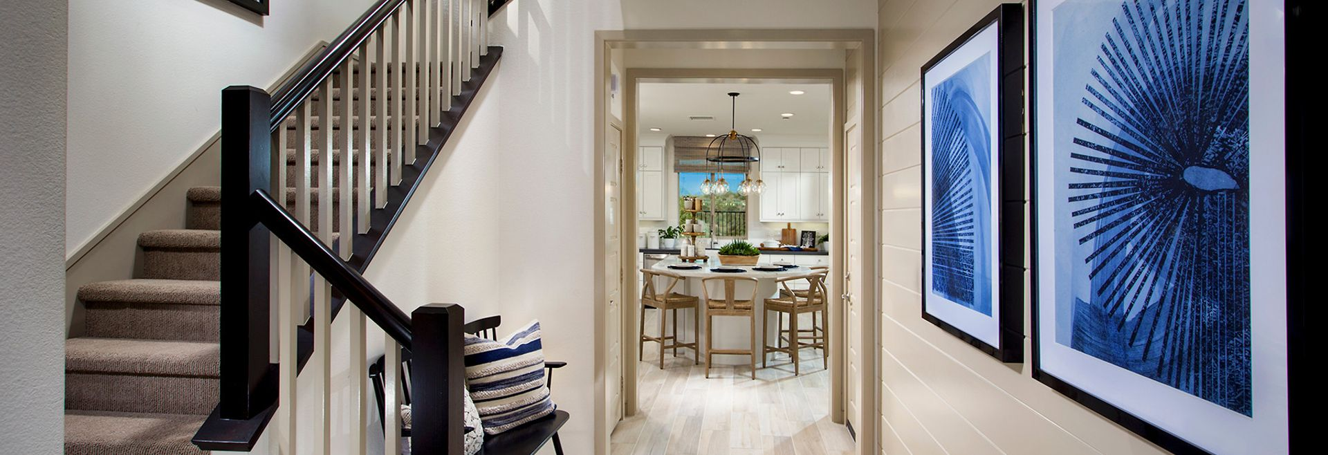 Entryway with art work and bench at Bristol at Baker Ranch by Shea Homes