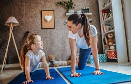 Mom and daughter working out together