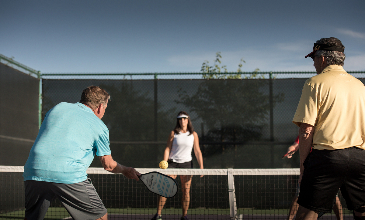 Trilogy Homeowners Playing Pickleball