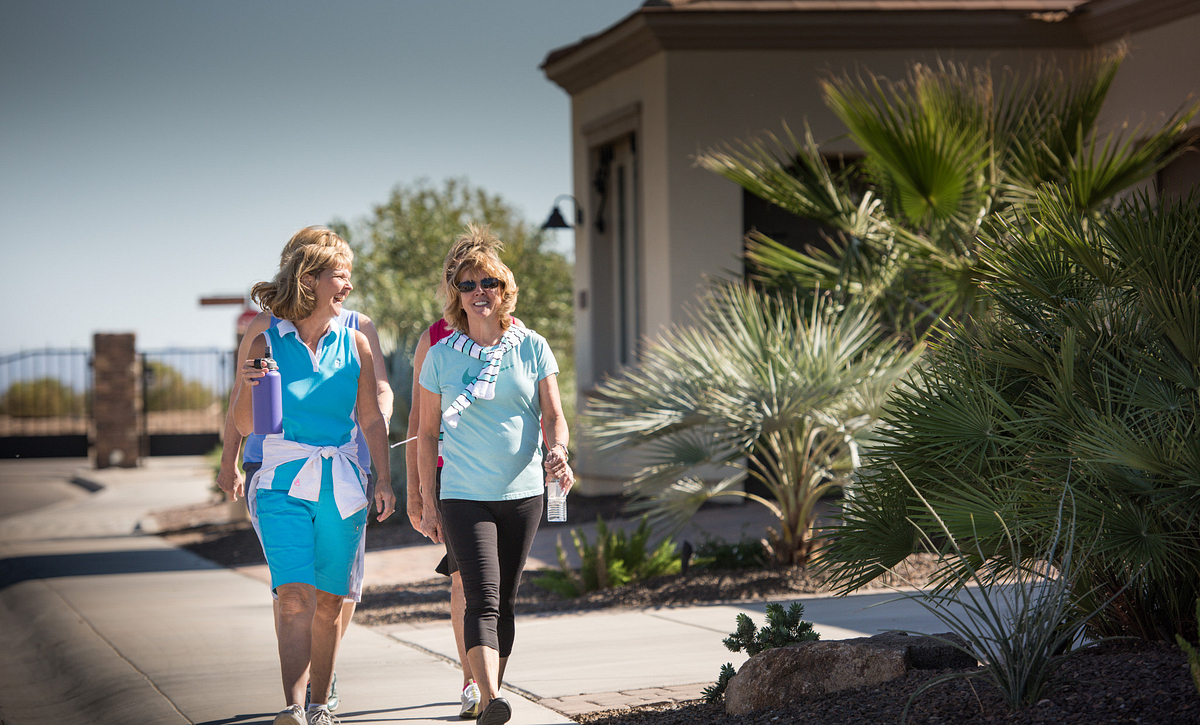 Trilogy Homeowners Taking a Walk