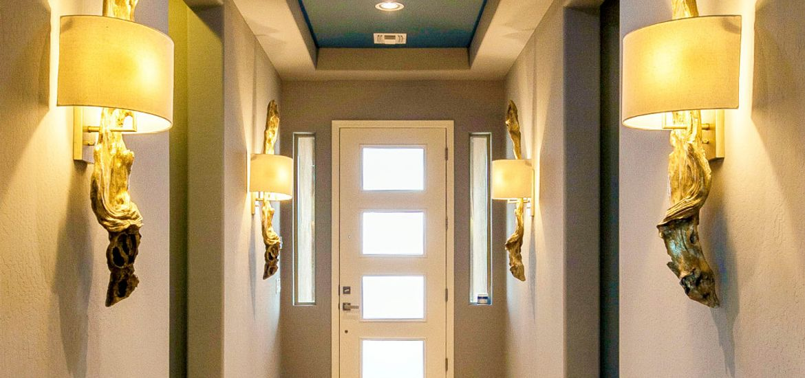 Hallway of home showing recessed lighting that is power by solar energy